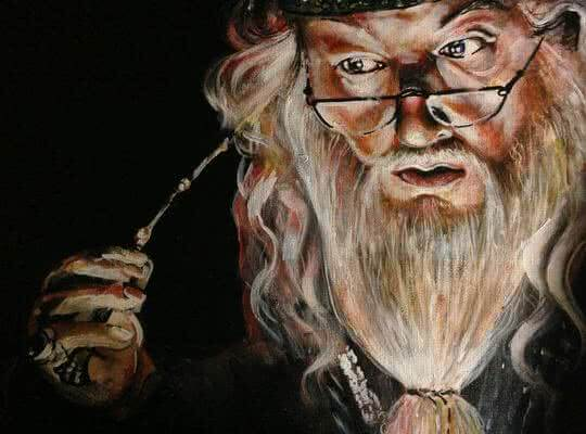Alus Dumbledore places his wands to his forehead extracting memories for Hogwart's pensieve